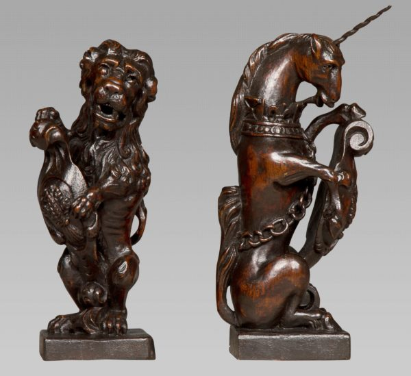 Exceptional Pair of Charles II Heraldic Newel Post Carvings