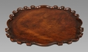 A Spanish or Portuguese Colonial Mahogany Scalloped Tray After a Silver Original